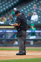 Home plate umpire Olindo Mattia writes in his notebook during the game between the Notre Dame Fighting Irish and the Florida State Seminoles in Game Four of the 2017 ACC Baseball Championship at Louisville Slugger Field on May 24, 2017 in Louisville, Kentucky. The Seminoles walked-off the Fighting Irish 5-3 in 12 innings. (Brian Westerholt/Four Seam Images)
