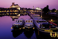 Auxerre, France, Burgundy, Yonne, Bourgogne, Europe, wine region, View of the Cathedral St. Etienne and house barges along the Yonne River in the evening in the city of Auxerre.