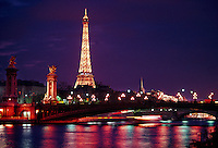 twilight view of the Pont Alexandre III (bridge) and the Eiffel Tower from the River Seine, Paris, France