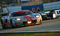 19 March 2011: The#040 Ford GT of David Robertson, Andrea Robertson and Boris Said races next to the #063 Oreca FLM09 of Eric Lux, Elton Julian and Christian Zugel during the 12 Hours of Sebring, Sebrng International Raceway, Sebring, FL. (Photo by Brian Cleary/www.bcpix.com)