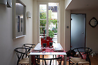 The French doors lead out into the garden from the dining area, opening up the space