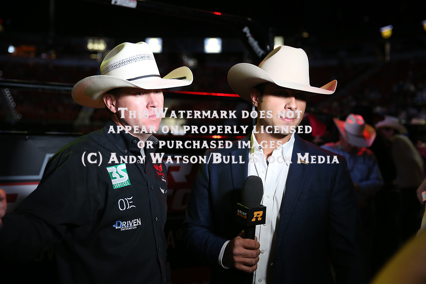 Anthony Lucia interviews Trevor Brazile for RidePass during the second round of the Las Vegas WCRA rodeo. Photo by Andy Watson