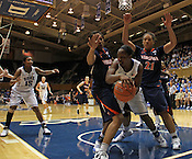 Chelsea Gray tries to go around Virginia defense. Duke woman's basketball beat Virginia 77-66 on Monday, January 2, 2012 at Cameron Indoor Stadium in Durham, NC. Photo by Al Drago.