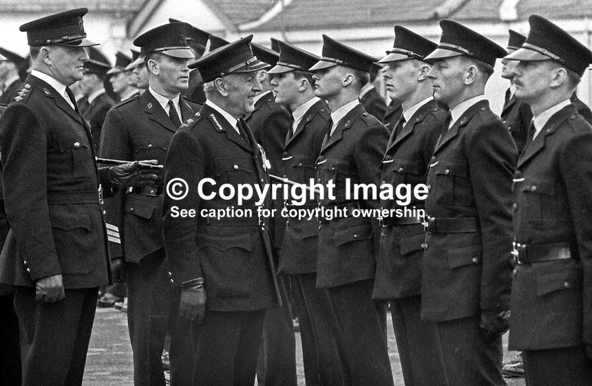 RUC recruits passing out from the RUC training depot in Enniskillen, Co Fermanagh, N Ireland, are inspected by Graham Shillington, the deputy inspector general. Extreme left is John Hermon, later Sir John Hermon and a Chief Constable of the RUC. 29th January 1970. 197001290061a<br />