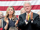 Washington, DC - June 7, 2008 -- Chelsea Clinton, left, and former United States President Bill Clinton, right, applaud as United States Senator Hillary Rodham Clinton (Democrat of New York) announces her support for United States Senator Barak Obama's (Democrat of Illinois) bid for President of the United States at an event Washington, D.C. on Saturday, June 7, 2008..Credit: Ron Sachs / CNP.(RESTRICTION: NO New York or New Jersey Newspapers or newspapers within a 75 mile radius of New York City)