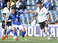 BOGOTA - COLOMBIA -26 -07-2015: Maximiliano Nuñez (Izq) jugador de Millonarios disputa el balón con Franklin Lucena (Der) jugador de Once Caldas durante partido por la fecha 3 de la Liga Águila II 2015 jugado en el estadio Nemesio Camacho El Campín de la ciudad de Bogotá./ Maximiliano Nuñez (L) player of Millonarios fights for the ball with Franklin Lucena (R) player of Once Caldas during the match for the third date of the Aguila League II 2015 played at Nemesio Camacho El Campin stadium in Bogotá city. Photo: VizzorImage / Gabriel Aponte / Staff.