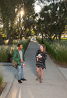 Deon Summerville '16 and Rachel Wein '17 stand on the sidewalk at the entrance. The Mullin Entrance (main entrance) to Occidental College, Nov. 5, 2015, Los Angeles, Calif.<br />