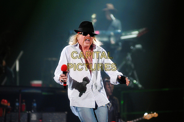 """Axl Rose of Guns N' Roses performs on stage at Copps Coliseum in support of """"Chinese Democracy"""", Hamilton, Ontario, Canada..24th January 2010 .concert live gig performance music half length white shirt unbuttoned necklace black hat sunglasses shades handlebar moustache mustache facial hair mouth open.CAP/ADM/BPC.©Brent Perniac/AdMedia/Capital Pictures."""
