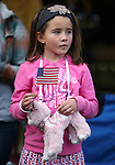 Julianna Evans, 7, watches the Veteran's Day Parade in Virginia City, Nev., on Tuesday, Nov. 11, 2014.<br /> Photo by Cathleen Allison