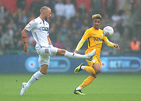 Swansea City's Mike van der Hoorn under pressure from Preston North End's Callum Robinson<br /> <br /> Photographer Kevin Barnes/CameraSport<br /> <br /> The EFL Sky Bet Championship - Swansea City v Preston North End - Saturday August 11th 2018 - Liberty Stadium - Swansea<br /> <br /> World Copyright &copy; 2018 CameraSport. All rights reserved. 43 Linden Ave. Countesthorpe. Leicester. England. LE8 5PG - Tel: +44 (0) 116 277 4147 - admin@camerasport.com - www.camerasport.com