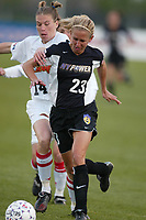 Emily Stauffer of the NY Power attempts to get by Erica Iverson of the Philadelpia Charge during the NY Power's home opener at Mitchell Athletic Complex on April 27. The Power lost 2-1.
