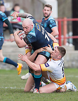 Picture by Allan McKenzie/SWpix.com - 25/03/2018 - Rugby League - Betfred Championship - Batley Bulldogs v Featherstone Rovers - Heritage Road, Batley, England - Featherstone's John Davies is tackled by Batley's Alistair Leak.