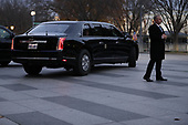 The presidential limousine carries U.S. President Donald Trump across Pennsylvania Avenue and back to the White House after Trump visited the family of former President George H.W. Bush at Blair House December 04, 2018 in Washington, DC. The Trumps were paying a condolence visit to the Bush family who are in Washington for former President George H.W. Bushs state funeral and related honors. <br /> Credit: Chip Somodevilla / Pool via CNP