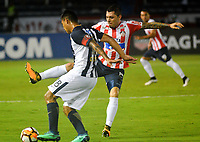 BARRANQUILLA - COLOMBIA, 26-04-2018: Leonardo Pico (Der.) jugador de Atlético Junior disputa el balón con Reinaldo Cruzado (Izq.) jugador de Alianza Lima, durante partido entre Atlético Junior (Col) y Alianza Lima (PER), de la fase de grupos, grupo H, fecha 4, por la Copa Conmebol Libertadores 2018, jugado en el estadio Metropolitano Roberto Meléndez de la ciudad de Barranquilla. / Leonardo Pico (R) player of Atletico Junior vies for the ball with Reinaldo Cruzado (L) player of Alianza Lima, during a match between Atletico Junior (Col) and Alianza Lima (PER), of the group stage, group H, 4th date for the Copa Conmebol Libertadores 2018 at the Metropolitano Roberto Melendez Stadium in Barranquilla city. Photo: VizzorImage  / Alfonso Cervantes / Cont.