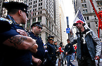 "The ""Occupy Wall Street"" movement continues to hold peaceful protests against the economic system around Wall Street the demonstrators have called people to ""flood into lower Manhattan, set up tents, peaceful barricades and occupy Wall Street for a few months."" for the third straight day on Monday in Zuccotti Park New York September 19 , 2011.VP/Kena Betancur"