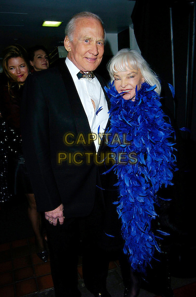BUZZ ALDRIN & WIFE.At Andy & Patti Wong's Chinese New Year Party,.Madame Tussards,London, England, January 27th 2007..half length blue featehr boa.CAP/CAN.©Can Nguyen/Capital Pictures