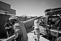 Anti-Gaddafi fighters load Grad rockets to launch towards Gaddafi loyalist positions in Sirte, Libya.