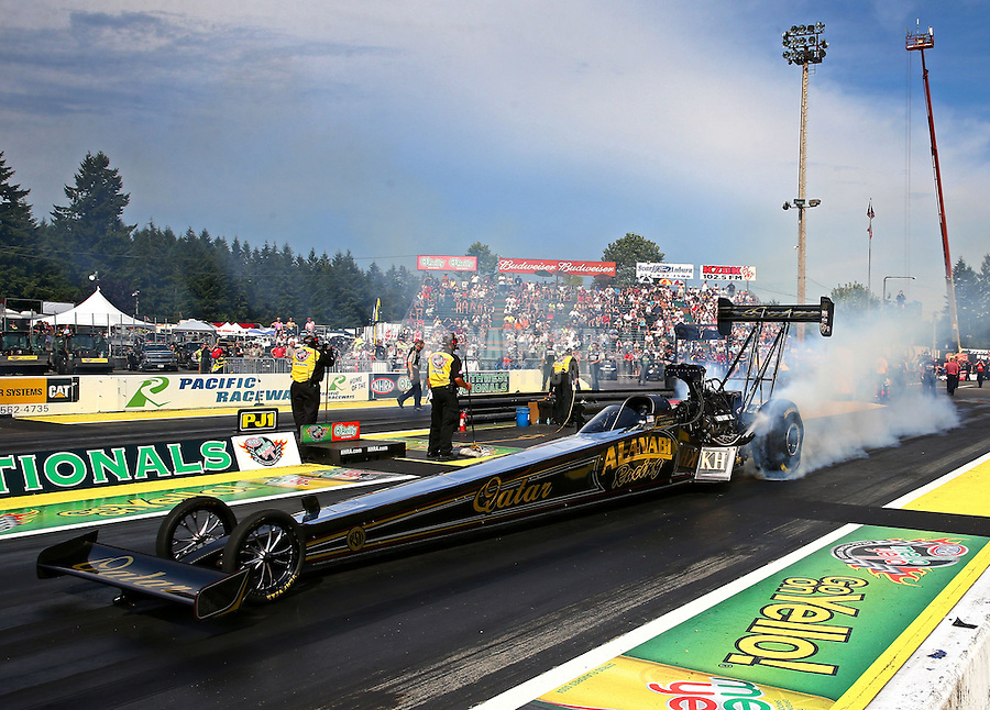 Aug. 1, 2014; Kent, WA, USA; NHRA top fuel dragster driver Khalid Albalooshi during qualifying for the Northwest Nationals at Pacific Raceways. Mandatory Credit: Mark J. Rebilas-USA TODAY Sports