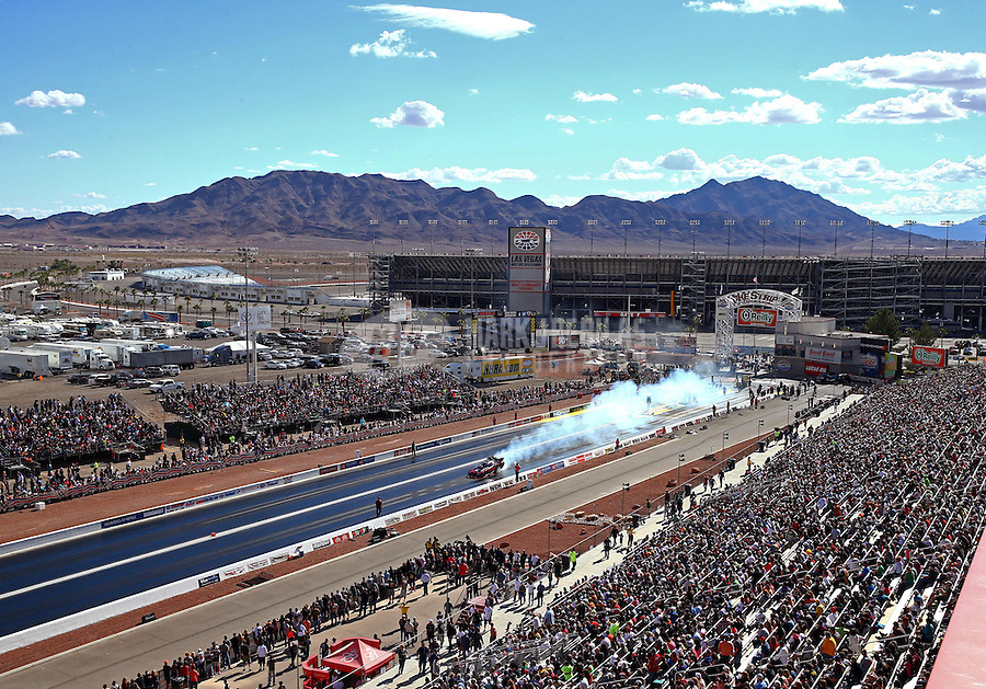 Nov 2, 2014; Las Vegas, NV, USA; Overall view of The Strip at Las Vegas Motor Speedway as NHRA funny car driver Alexis DeJoria does a burnout. Mandatory Credit: Mark J. Rebilas-USA TODAY Sports