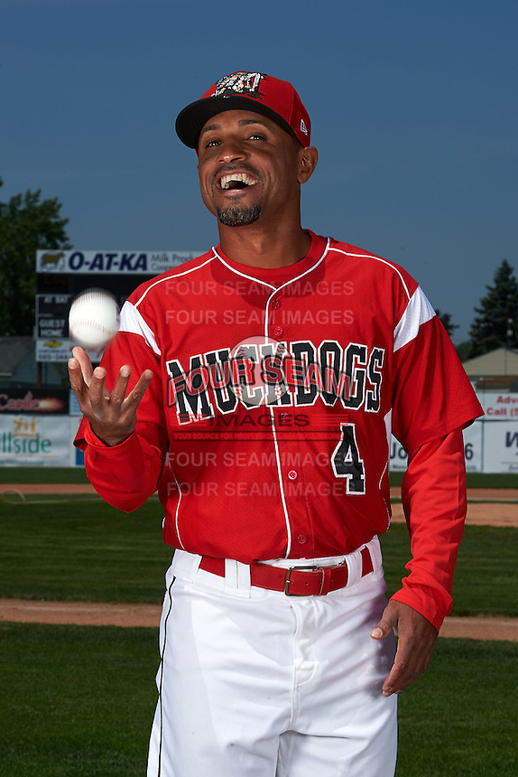 Batavia Muckdogs manager Angel Espada #4 jokes around during photo day before the teams first official practice on June 15, 2013 at Dwyer Stadium in Batavia, New York.  (Mike Janes/Four Seam Images)