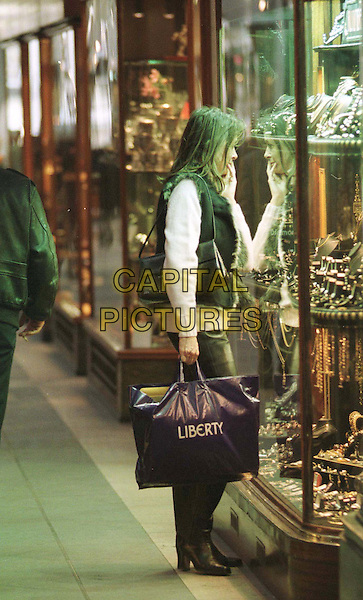 CHERIE LUNGHI .shopping, looking in shop window, leather trousers, full length, full-length, shopping bags.www.capitalpictures.com.sales@capitalpictures.com.© Capital Pictures