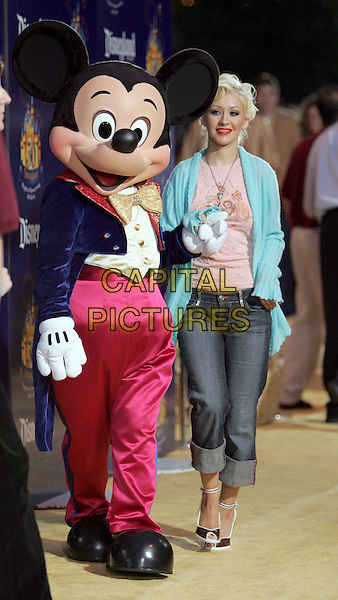 MICKEY MOUSE & CHRISTINA AGUILERA.Disneyland's 50th Anniversary kick off party held at Disneyland in Anaheim, California .May 4th, 2005.full length rolled up jeans denim blue cardigan pink t-shirt t shirt heels holding hands costume.www.capitalpictures.com.sales@capitalpictures.com.Supplied By Capital PIctures