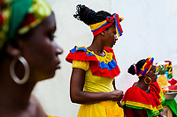 Afro-Colombian women, dressed in the traditional 'palenquera' costume, sell fruits on the street of Cartagena, Colombia, 12 December 2017. With the peace agreement, ending a 52-year civil conflict and promising political stability, together with rapid economic growth and unexploited tourism potential, Colombia has truly become a holiday destination. Cartagena, a UNESCO World Heritage site on the tropical Caribbean coast, plays the primary role in Colombia's tourism renaissance. The historic sites from the Spanish colonial times are being restored, private investments are visible throughout the city and an increased number of local people benefit from the boom of the travel related services.