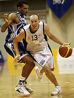 Giants guard Phill Jones gets past Mike Efevberha during the NBL Round 2 basketball match between the Wellington Saints and Nelson Giants at TSB Bank Arena, Wellington, New Zealand on Thursday 19 March 2009. Photo: Dave Lintott / lintottphoto.co.nz
