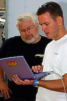Bill Hesson & Brenden Power analyze data from Wyatt Nelson's boat.