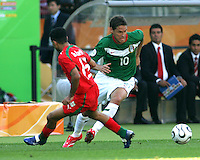 Guillermo Franco of Mexico puts  move on Hossein Kaabi of Iran. Mexico defeated Iran 3-1 during a World Cup Group D match at Franken-Stadion, Nuremberg, Germany on Sunday June 11, 2006.