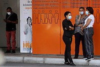 MEDELLIN, COLOMBIA - March 16: A woman wear face mask as a preventive measure against the spread of the new Coronavirus, COVID-19, at the entrance of a hospital in Medellin, Colombia on March 16, 2020. The Colombian government announced the indefinite suspension of face-to-face classes in public schools and universities as a preventive measure against the COVID-19 pandemic. (Photo by Fredy Builes/VIEWpress via Getty Images)