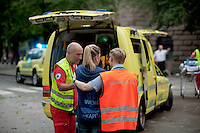 Oslo Norway 20110722 -  Terror attack on the government quarters in Oslo and AUF youth camp at Utoya / Utøya.  Pictured:  paramedics help girl in shock, 20 meters away from the bomb site. Photo/copyright: Torbjorn Gronning.