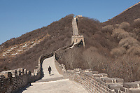 A visitor walks along the end of Mutianyu Great Wall toward Jiankou, the wild part of the Great Wall.