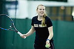 Wake Forest Demon Deacons volunteer assistant coach Daneika Borthwick helps the team warm-up prior to their match against the Liberty Flames at the Wake Forest Indoor Tennis Center on March 11, 2017 in Winston-Salem, North Carolina. The Demon Deacons defeated the Flames 7-0.  (Brian Westerholt/Sports On Film)
