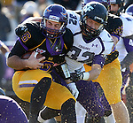 MANKATO, MN - NOVEMBER 1:  Cameron Ostrom #32 for the University of Sioux Falls brings down Nick Pieruccini #6 from Minnesota State Mankato in the second quarter Saturday afternoon at Blakeslee Stadium in Mankato. (Photo by Dave Eggen/Inertia)