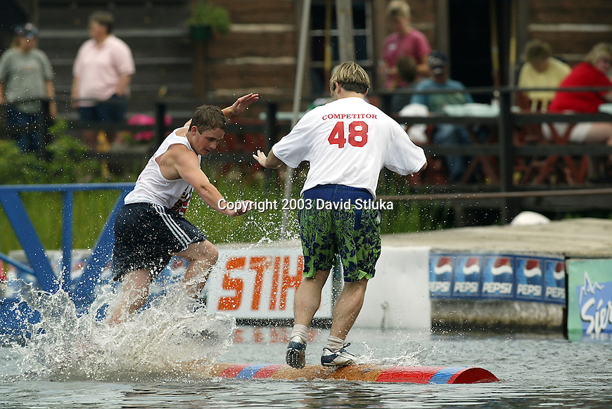 7/25/03 -Hayward, Wisconsin. Logrolling competition at the Lumberjack World Championships on Friday. Doug Goodmundson (51) vs. Travis Wells (48). (Photo by David Stluka)