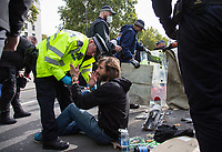 Protesters are removed from the road (Whitehall)<br /> .<br /> Environmental activists from Extinction Rebellion protest in London on 09 October 2019 in London, England.<br /> .<br /> Protesters plan to blockade the London government district for a two week period, as part of 'International Rebellion' taking place in over 60 cities around the world, calling for decisive and immediate action from governments in the face of climate and ecological emergency. <br /> .<br /> Photo by Andy Rowland.