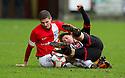 Pars' Josh Falkingham and Ayr Utd's Gordon Pope challenge for the ball.