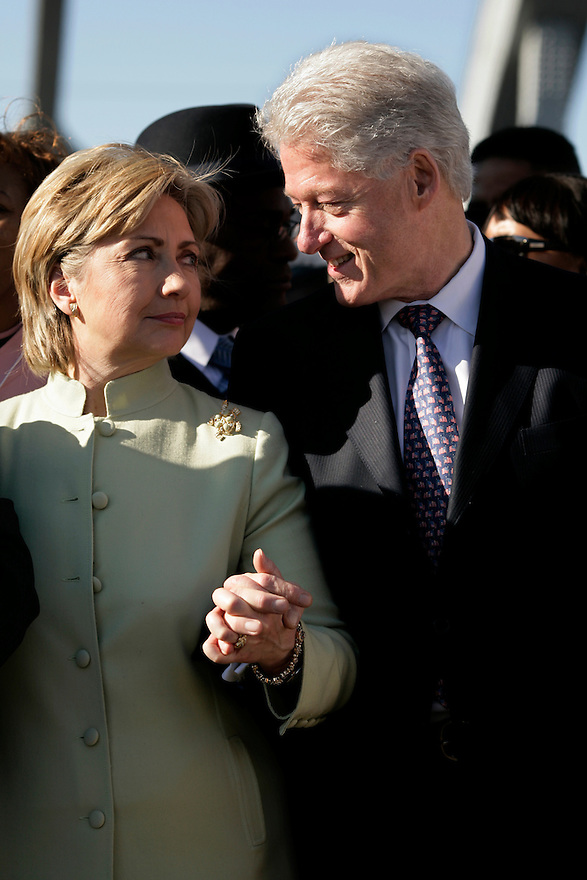 U.S. presidential candidate Senator Hillary Clinton (D-NY) and her husband, former U.S. President Bill Clinton (C), pause along the Edmund Pettus Bridge during a march commemorating the 1965 Selma-Montgomery Voting Rights March in Selma, Alabama, March 4, 2007.<br /> Photo by Brooks Kraft/Corbis