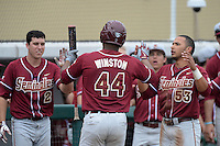 Florida State Seminoles designated hitter / relief pitcher Jameis Winston (44) is congratulated by Josh Delph (2) and Jose Brizuela (53) after scoring a run during a game against the South Florida Bulls on March 5, 2014 at Red McEwen Field in Tampa, Florida.  Florida State defeated South Florida 4-1.  (Mike Janes/Four Seam Images)