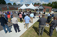 NWA Democrat-Gazette/ANDY SHUPE<br /> Visitors and employees gather Tuesday, Sept. 11, 2018, during a dedication ceremony for the Leroy Pond Residential Treatment Facility at Veterans Health Care System of the Ozarks in Fayetteville. The facility offers 20 beds 20-beds and inpatient care for veterans who are facing substance abuse and co-occurring mental illness and homelessness.