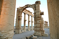 Monumental arch, erected under Septimius Severus, Roman emperor, 193-211 AD, smaller arch and Great Colonnade in distance, Palmyra, Syria Picture by Manuel Cohen