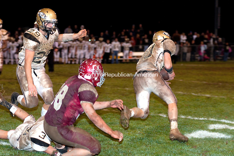 NAUGATUCK, CT, 01 NOVEMBER 2010-110110JS07-Naugatuck's Jake Yourison (38) can only look on as a pass intended for him is intercepted and run back for a touchdown by Woodland's Jack DeBiase (10) during their game Friday at Naugatuck High School. <br />  Jim Shannon Republican-American