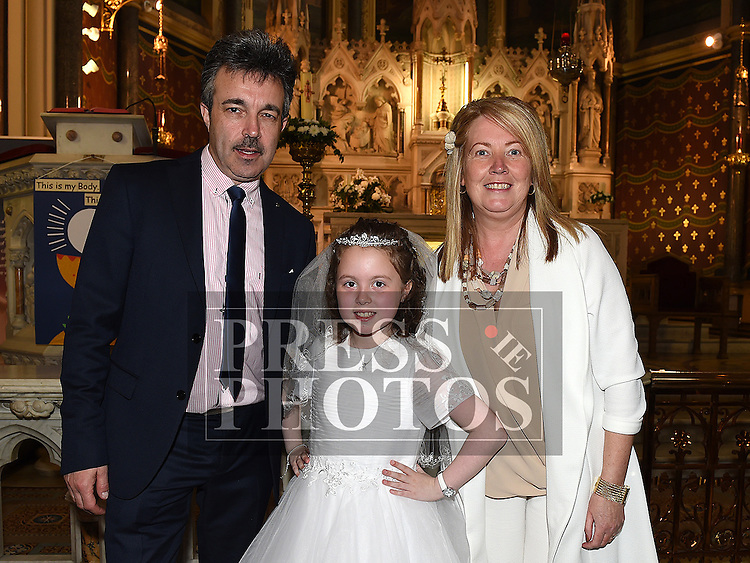 Olivia Harty who received her First Holy Communion in St. Peters Church pictured with parents Pat and Pamela. Photo:Colin Bell/pressphotos.ie