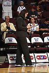 March 5, 2015; Las Vegas, NV, USA; Loyola Marymount Lions head coach Charity Elliott writes on a whiteboard against the Pepperdine Waves before the game of the WCC Basketball Championships at Orleans Arena.