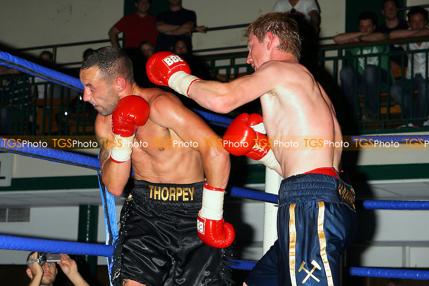 Joe Catchpole (blue/gold shorts) defeats Daniel Thorpe in a Light-Welterweight Boxing contest at York Hall, Bethnal Green, promoted by Hard Knocks / Spencer Fearon - 04/06/10 - MANDATORY CREDIT: Gavin Ellis/TGSPHOTO - Self billing applies where appropriate - Tel: 0845 094 6026