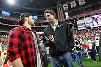 Former Major League Baseball pitcher Randy Johnson, right, talks to Bryce Harper, an Ohio State fan who plays for the Washington Nationals, prior to Ohio State's 44-28 win over the Notre Dame Fighting Irish in the Battlefrog Fiesta Bowl at University of Phoenix Stadium in Glendale, Arizona on Jan. 1, 2016. (Adam Cairns / The Columbus Dispatch)