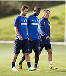 USA duo Carlos Bocanegra and Maurice Edu ponder their futures with Rangers as they walk out for training with Ian Black
