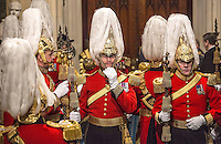 18 May 2016 - London England - Members of the honourable corps of gentlemen at arms adjust their head dress as they for the arrival of the Queen on the day of the traditional and ornate state opening of Parliament ceremony. The State Opening of Parliament marks the formal start of the parliamentary year and the Queen's Speech sets out the government's agenda for the coming session. Photo Credit: ALPR/AdMedia