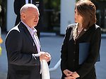 Former Rep. Gabrielle Giffords' husband Mark Kelly talks with Attorney General Catherine Cortez Masto before a press conference in front of the Legislative Building, in Carson City, Nev., on Friday, May 31, 2013. <br /> Photo by Cathleen Allison
